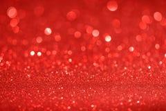 Weihnachtsneues Jahr-Valentine Day Red Glitter-Hintergrund Abstraktes Beschaffenheitsgewebe des Feiertags Element, Blitz stockfoto