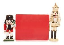 Weihnachtsnussknacker mit leerem Zeichen Lizenzfreies Stockbild