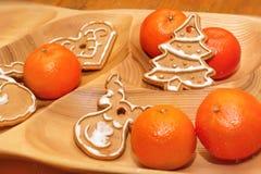 Weihnachtsplätzchen und -tangerinen Stockbild