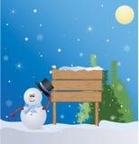 Weihnachtsplatz mit Schneemann Stockfotos
