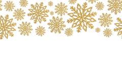 Weihnachtsrahmen mit Goldschneeflocken Grenze von Paillettekonfettis Stockfotos
