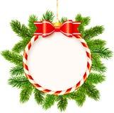 Weihnachtsrahmen mit roten Bogen- und Tannenbaumasten Stockfotos