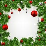 Weihnachtsrahmen mit Tannenzweigen und Bällen. Stockfotos