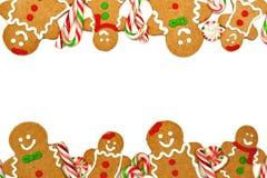 Weihnachtsrahmen von Lebkuchenmännern und -süßigkeiten lizenzfreie stockbilder
