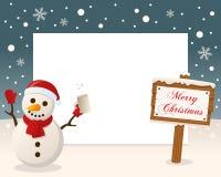 Weihnachtsrahmen-Zeichen u. betrunkener Schneemann Stockfoto