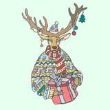 Weihnachtsren mit Geschenk und einer Strickjacke in Stockfotos