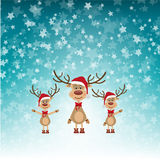 Weihnachtsrene in Santa Hats Lizenzfreies Stockfoto