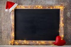 Weihnachtsrustikaler Hintergrund - Weinlese planked Holz mit Lichtern a Lizenzfreie Stockfotos