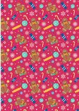 Weihnachtssüßigkeits-Lutscher Gingerman im rosa Hintergrund Stockbild