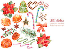 Weihnachtssammlung: Bonbons, Poinsettia, Anis, Orange, Kiefernkegel, Bänder, Weihnachten backt zusammen Stockfotografie