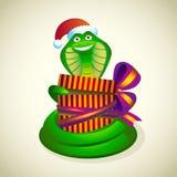 Weihnachtsschlange mit einem Geschenk. Stockbild