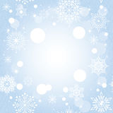 Weihnachtsschneeflocke auf blauem Hintergrund Stockfotografie