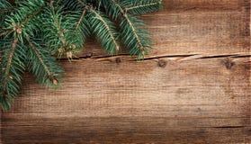 Weihnachtsschneeflocken auf hölzernem Hintergrund Lizenzfreies Stockfoto