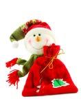 WeihnachtsSchneemann mit Sack Geschenken Stockfoto