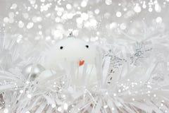 Weihnachtsschneemannflitter im Lametta Stockfotos