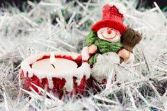 WeihnachtsSchneemannkerze Stockbilder