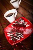 Weihnachtsschokoladenkuchennachtisch mit Granatapfel und Kaffee Stockbild