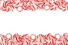 Weihnachtssüßigkeitsdoppeltgrenze über Weiß Stockfotos