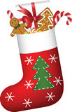 Weihnachtssocke voll der Geschenke Lizenzfreies Stockbild