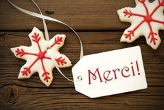 Weihnachtsstern-Plätzchen mit Merci Lizenzfreie Stockfotos