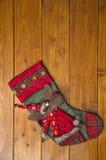 Weihnachtsstiefel mit einem Rotwild Lizenzfreie Stockfotos