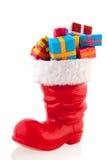 Weihnachtsstiefel mit Geschenken Stockfoto