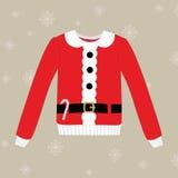 Weihnachtsstrickjacke auf Hintergrund mit Schneeflocken Lizenzfreie Stockfotos