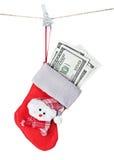 Weihnachtsstrumpf angefüllt mit dem Geld lokalisiert Lizenzfreies Stockbild