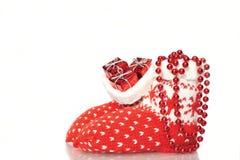 Weihnachtsstrumpf mit Geschenken Stockbilder