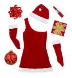 Weihnachtssymbole und Frauenkleidung lokalisiert auf Weiß Lizenzfreie Stockfotos