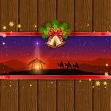 Weihnachtsszene auf hölzernem Hintergrund mit Glocken und Bogen Lizenzfreies Stockfoto