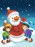 Weihnachtsszene mit Schneemann Stockfotografie