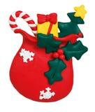 Weihnachtstasche mit den Geschenken gemacht vom Polymerlehm Stockfoto