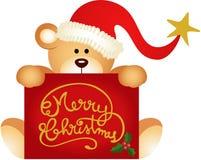 Weihnachtsteddybär, der frohen Weihnachten hält Lizenzfreie Stockbilder