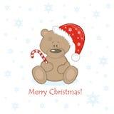 WeihnachtsTeddybär in der roten Glocke mit Bonbon Lizenzfreie Stockfotografie