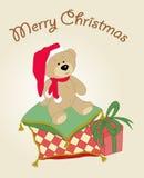 Weihnachtsteddybär mit einem Geschenk Stockfotografie
