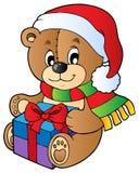 WeihnachtsTeddybär mit Geschenk Lizenzfreie Stockbilder