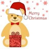 WeihnachtsTeddybär mit rotem Sankt-Hut Lizenzfreies Stockbild