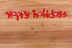 Weihnachtstext frohe Feiertage Stockbilder