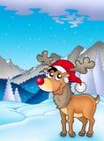 Weihnachtsthema mit nettem Ren Stockbild