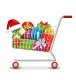 Weihnachtsverkaufs-bunter Warenkorb mit Geschenkboxen und Taschen I Stockfoto