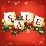 Weihnachtsverkaufshintergrund im Rot und im Gold Stockfotos
