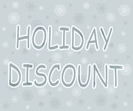 Weihnachtswerbetext mit Schneeflocken auf grauem Himmel Lizenzfreies Stockfoto