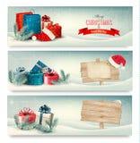 Weihnachtswinterfahnen mit Geschenken. Lizenzfreie Stockfotografie