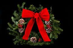 WeihnachtsWreath auf Schwarzem Stockbild