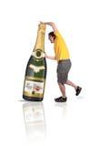 Weihnachtszeit - sehr große Champagne-Flasche lizenzfreie stockfotos