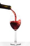 Wein, der in ein Glas gießt Stockbilder