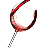 Weinansammlung - Rotwein wird in ein Glas gegossen stockbilder