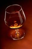 Weinbrand in einem Glas Stockbild