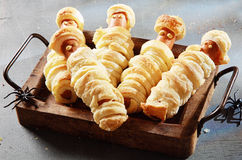 Weiner Mummies Wrapped in Pastry on Tray Stock Images